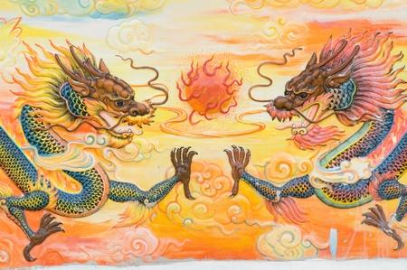 chinese wall: pittura drago cinese tempio parete Nakhonprathom provincia Thailandia Editoriali
