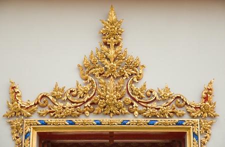 beautiful Thai art above thai temple door photo