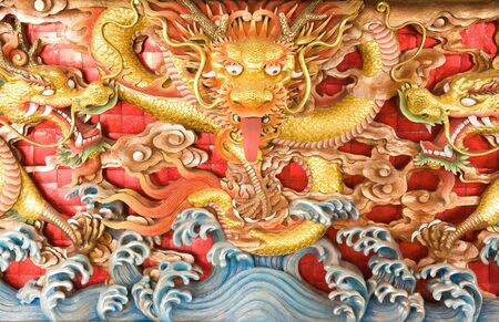 dragon wooden sculpture on Chinese temple wall photo
