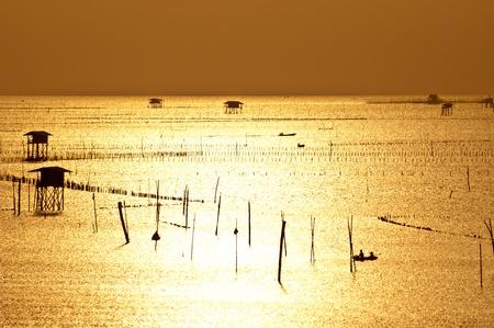 silhouette fishermen life in the morning at Samutsongkram province Thailand photo