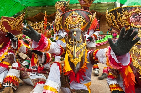 fancy mask in Phi Ta Khon festival , tradition at Dan Sai district Loei province Thailand photo