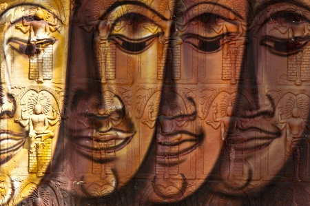 the arts is ancient: face of buddha image on temple wall