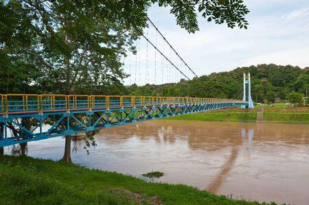 bridge across river at Uttaradit province Thailand photo