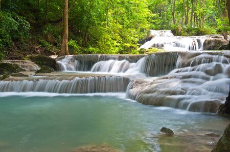 waterfall in tropical forest at Eravan national park Kanchanaburi province Thailand photo