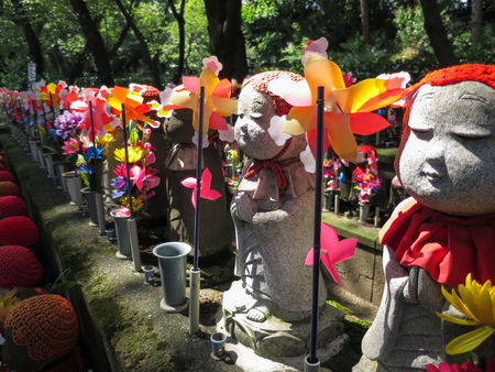 Stone statues of Jizo at the cemetery of Zojo-ji temple, Japan