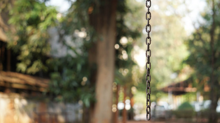 Rusty chain hanging in the air.