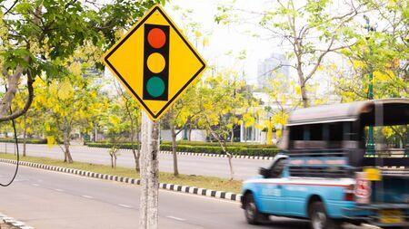 Traffic light sign,bus,Gloden shower tree.
