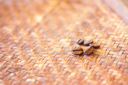 Roasted Arabica coffee Beans on bamboo basket for background