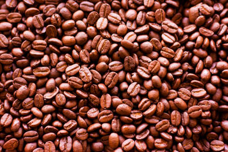 Roasted Arabica coffee beans for background Фото со стока