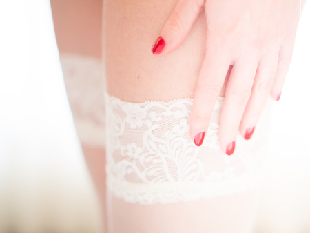 woman hands on white stockings Stockings Stock Photo