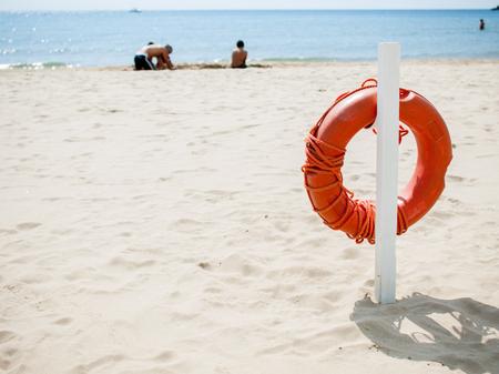 Life preserver on the beach Фото со стока