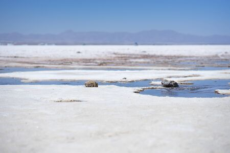 Salar de Uyuni surface with some water salt and rocks