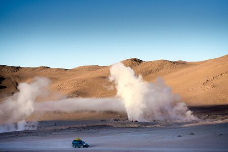 Sunshine Boivian desert landscape with huge steaming geysers