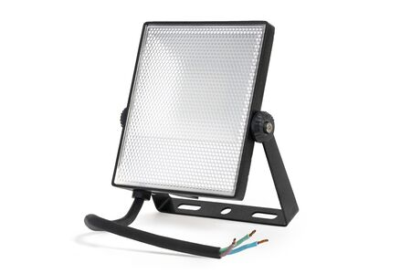 LED spotlight, power cable and mount bracket on a white background. Diffuser lightless with small cells. High resolution.