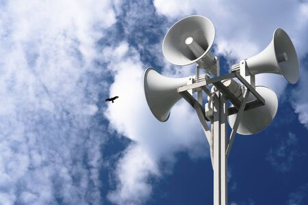 A column with four gray loudspeakers in a circle against a background of clouds and a flying bird. Hazard warning system. Ability to post your test or image.