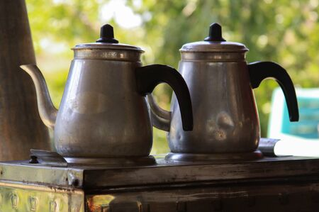 Two traditional turkish tea metal pots on a stove, in Alanya, Turkey 免版税图像