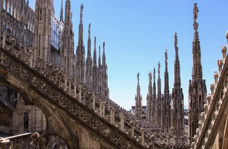 Pinnacles and arch buttress on Duomo di Milano (Milan Cathedral) rooftop, Lombardy, Italy - architecture detail design