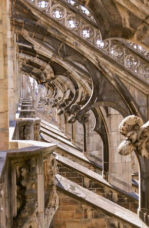 Under flying buttresses of Duomo di Milano (Milan Cathedral) rooftop, Lombardy, Italy - architecture detail design