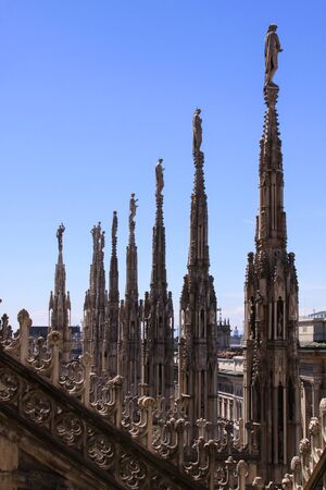 Pinnacles with statues of Duomo di Milano (Milan Cathedral) rooftop, Lombardy, Italy - architecture detail design Standard-Bild