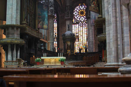MILAN, ITALY - May 26, 2013: illustrative editorial - Altar and stained glass windows inside Duomo di Milano (Milan Cathedral) rooftop, Lombardy, Italy - architecture detail design