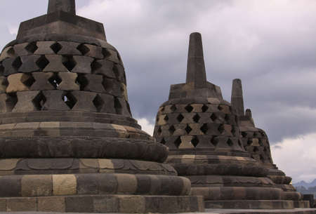 Stupas stone bell structures at Borobudur temple in Java Indonesia. Candi Borobudur is the largest Buddhist temple outside of India and one of the most important tourist attraction in Indonesia