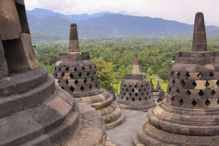 Borobudur temple and surrounding mountains, in Java Indonesia. Candi Borobudur is the largest Buddhist temple outside of India and one of the most important tourist attraction in Indonesia