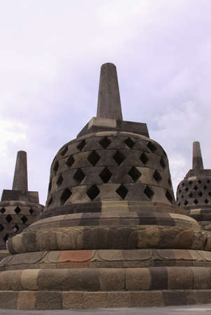 Stupas stone bell structures at Borobudur temple in Central Java, Indonesia. Candi Borobudur is the largest Buddhist temple in the world and one of the most important tourist attraction in Indonesia