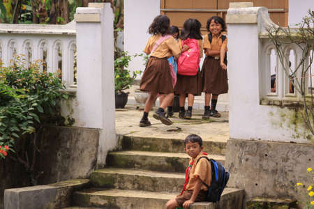 Probolinggo, Indonesia - June 14, 2013: Happy children smiling and playing after school in a village in East Java, Indonesia Editorial
