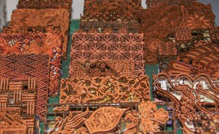 Wax copper stamps at Batik Winotosastro factory in Yogyakarta, Java, Indonesia. Batik motif sample designs on cloth. Editorial