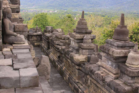 Borobudur temple level detail in Java Indonesia. Candi Borobudur is the largest Buddhist temple and one of the most important tourist attraction in Indonesia. The temple is build on nine platforms.