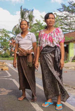 Local balinese women in Bali, Indonesia, dressed in batik dress for festivity Editorial