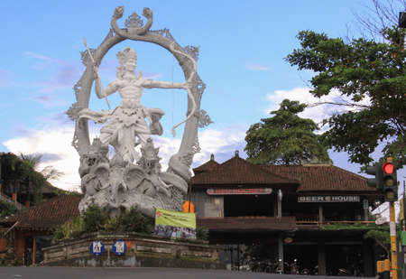 Arjuna Statue in the middle of a roundabout, a symbol in Ubud, Bali, Indonesia.