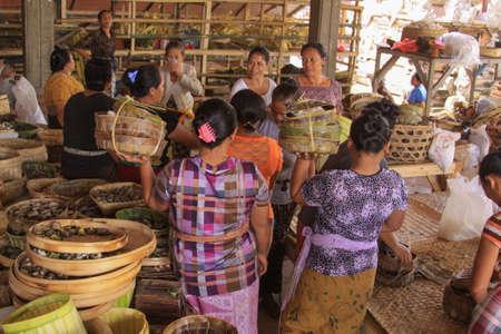 Local women dressed in batik preparing offerings for a coming festivity, in Bali, Indonesia