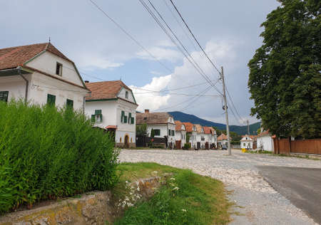 Rimetea village main street houses on cloudy day. Empty street in high season 2020, in Rimetea, Torocko, Alba county, Romania