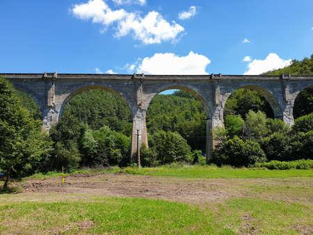 Cement train bridge outside of Brad town, Romania. Abandoned viaduct cement bridge for train architecture, linking Brad and Deva, Hunedoara, Transylvania, Romania