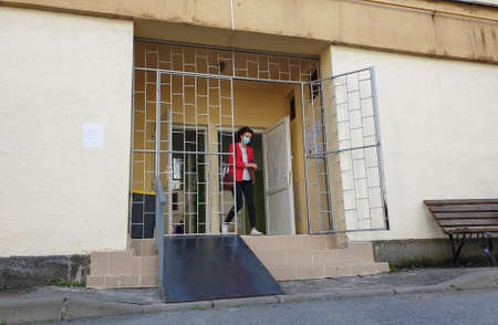 Cluj-Napoca, Romania - September 27, 2020: Local elections day in Romania. Woman exiting building after voting at local election