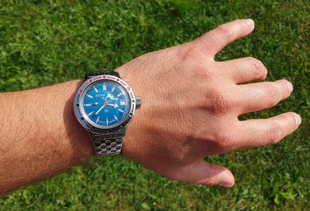 Cluj/Romania - September 19, 2020 - Illustrative editorial: Vintage Vostok russian automatic underwater watch on hand. Old cold war sovietic era timepiece. Retro communist Vostok Amphibia scuba dude Editorial