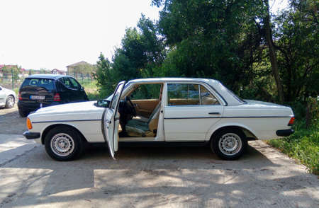 Mercedes Benz W123 Cobra with opened driver's door ready for fun drive