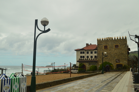 Infinite Maritime Walk Of Zarauz On A Rainy Day With Strong Wind Caused By The Temporary Hugo With Hotel Castle Restaurant Of Karlos Arguiñano To The Bottom. Landscapes Travel Architecture. March 26, 2018. Zarautz Guipuzcoa Basque Country Spain.