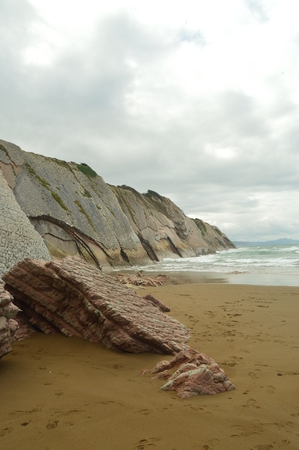 Pieces Of Pink Sandstone Wall Composed Of Fossil Records With Formations Of The Flysch Type Of The Paleocene Geopark