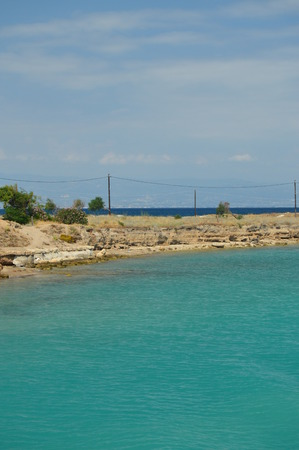 View From The Corinth Channel Of The Difference Of The Blue Color Of The Ionian Sea And The Aegean Sea. Architecture, Travel, Landscapes. July 8, 2018. Corinth Canal Peloponnesus Greece.