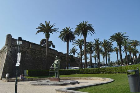 Statue Dedicated To King Charles And A Couple In Love Kissing Beside The Sculpture In Cascais. Photograph of Street, Nature, architecture, history. April 15, 2014. Cascais, Lisbon, Portugal.