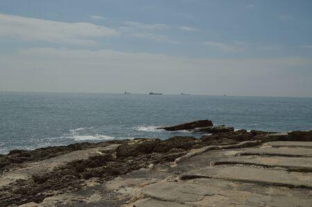 April 15, 2014. Estoril, Cascais, Sintra, Lisbon, Portugal. Rocks From Where To Contemplate The Atlantic Ocean On The Coast Of Estoril. Travel, Nature, Landscape.