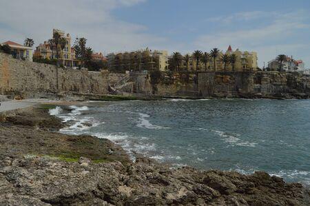 April 15, 2014. Estoril, Cascais, Sintra, Lisbon, Portugal. Beautiful House And Cliffs Near The Beach Of Poca On The Coast Of Estoril. Travel, Nature, Landscape.