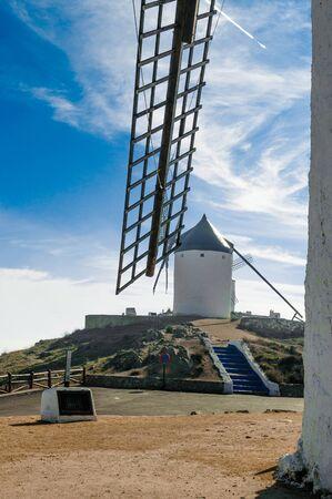 Windmill On Top Of Cerro Calderico Seen Through A Blade In Consuegra. December 26, 2018. Consuegra Toledo Castilla La Mancha Spain Europe. Travel Tourism Street Photography. 스톡 콘텐츠