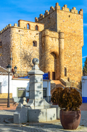 Rear Facade Of The Castle Fortress Of Manzaneque Dated In The 15th Century In Manzaneque. December 26, 2018. Manzaneque Toledo Castilla La Mancha Spain Europe. Travel Tourism Street Photography.