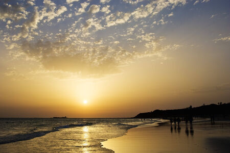 Horizontal photograph of a sunset on the beach of Barrosa, Chiclana, Cadiz, Spain