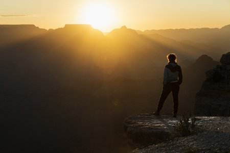 View of a girl watching sunset at Grand Canyon of Colorado