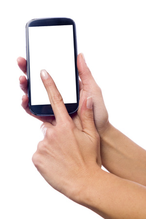 Photo isolated in white of a hand of a caucasian woman, touching the touch screen of a smartphone with white screen Archivio Fotografico