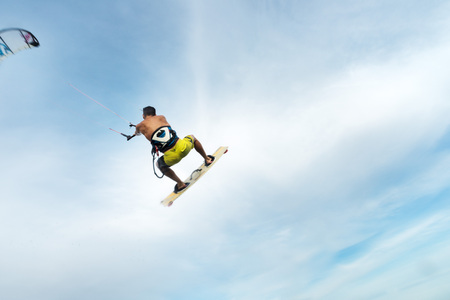 passing over: a surfer flying through the sky passing over the camera Stock Photo